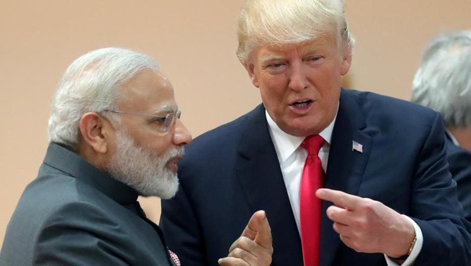 US President Donald Trump chats with India's Prime Minister Narendra Modi during a working session at the G20 leaders summit in Hamburg.
