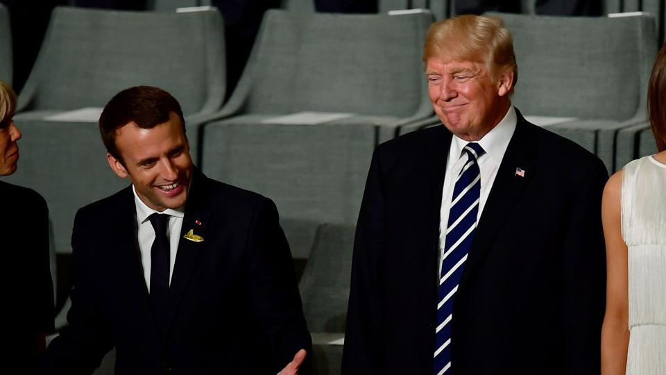 French President Emmanuel Macron (2ndL) and his wife Brigitte Trogneux (L) and US President Donald Trump and US First Lady Melania Trump attend a concert at the Elbphilharmonie concert hall during the G20 Summit in Hamburg.