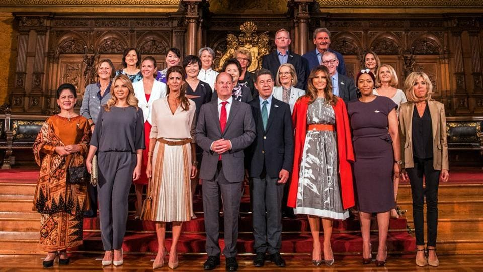 Hamburg's mayor Olaf Scholz (first row, C-L) poses with partners of the G20 summit participants at the city hall in Hamburg.  (AFP)