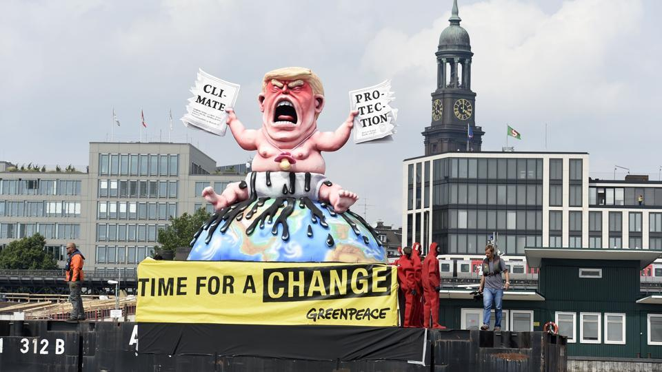 Greenpeace activists stand next to the giant statue of the U.S. President Donald Trump during the protest at the G20 summit in Hamburg. (REUTERS)
