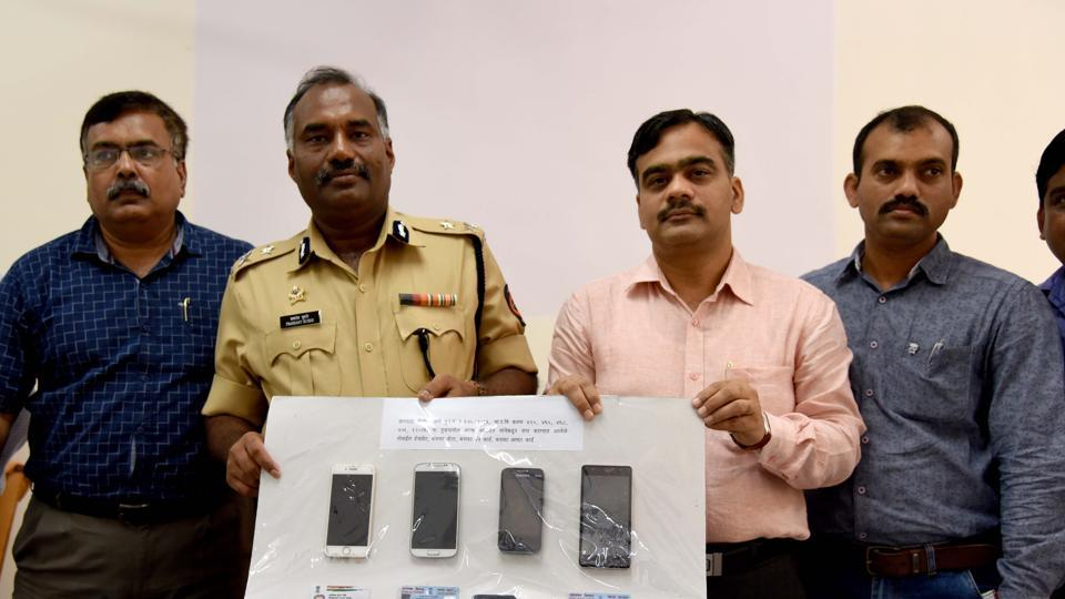 The Navi Mumbai police show recovered phones and bogus ID cards at the police commissioner's office on Friday.
