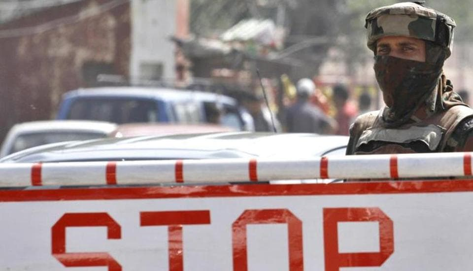 An Indian Army soldier stands guard near a check-post in Srinagar.