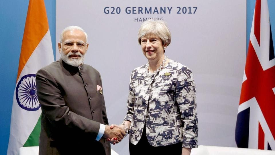 Prime Minister Narendra Modi met his British counterpart Theresa May on the sidelines of the G20 Summit and sought Britain's cooperation for the return of Indian economic offenders.  (PTI)
