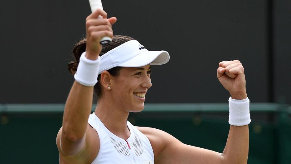 Garbine Muguruza reacts after beating Sorana Cirstea in their Wimbledon round of 32 fixture.