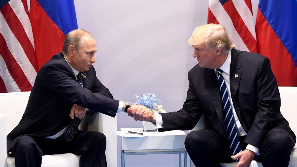 US President Donald Trump and Russia's President Vladimir Putin shake hands during a meeting on the sidelines of the G20 Summit in Hamburg, Germany, on Friday.