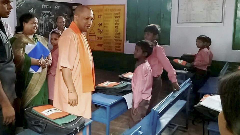 Uttar Pradesh chief minister Yogi Adityanath interacts with school children in Amroha.