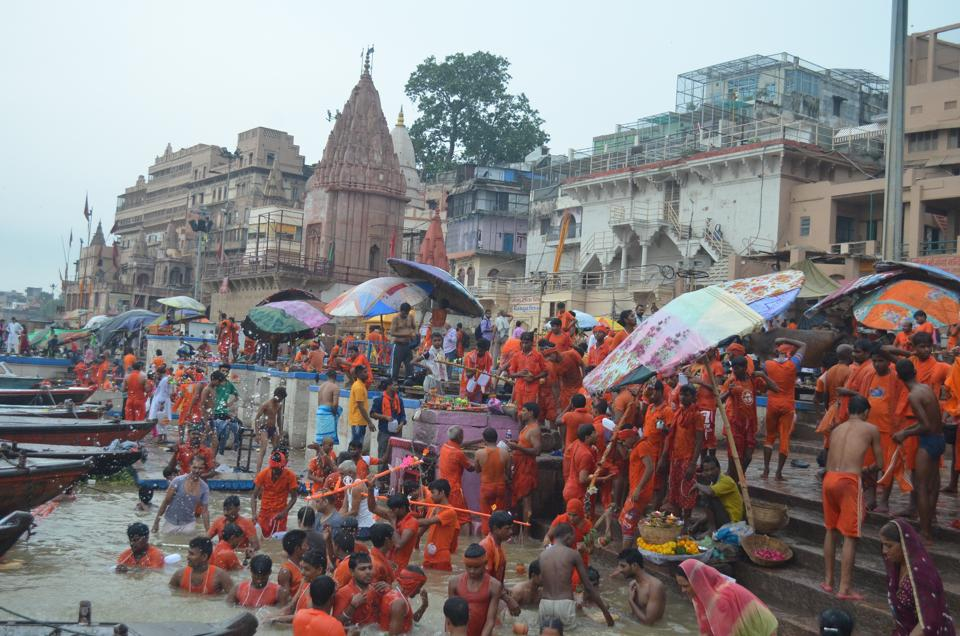 Iconic Dashashwamedh Ghat was flooded with a large number of saffron-robed kanwarias .