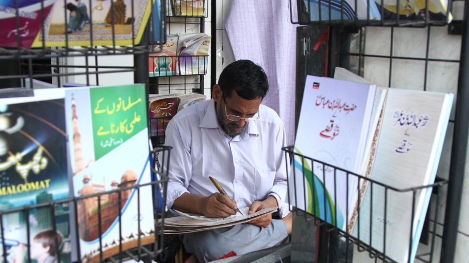 Mohammad Ghalib, one of the last calligraphers of Delhi, works in his small makeshift shop in Urdu Bazaar, near Jama Masjid.