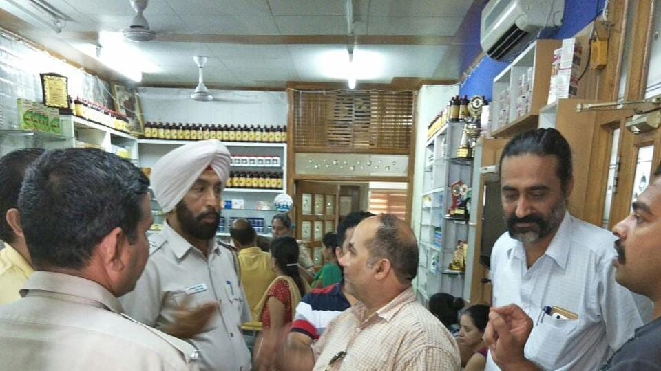 Police carrying out investigation at the shop in Sector 44, Chandigarh