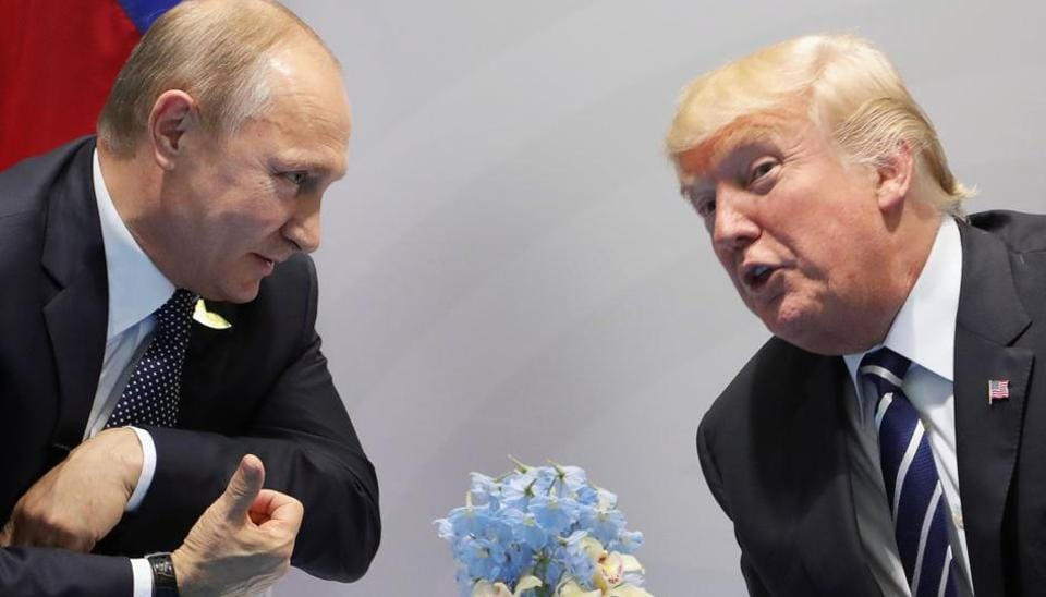 US President Donald Trump and Russia's President Vladimir Putin speak during their meeting on the sidelines of the G20 Summit in Hamburg, Germany, on July 7, 2017.