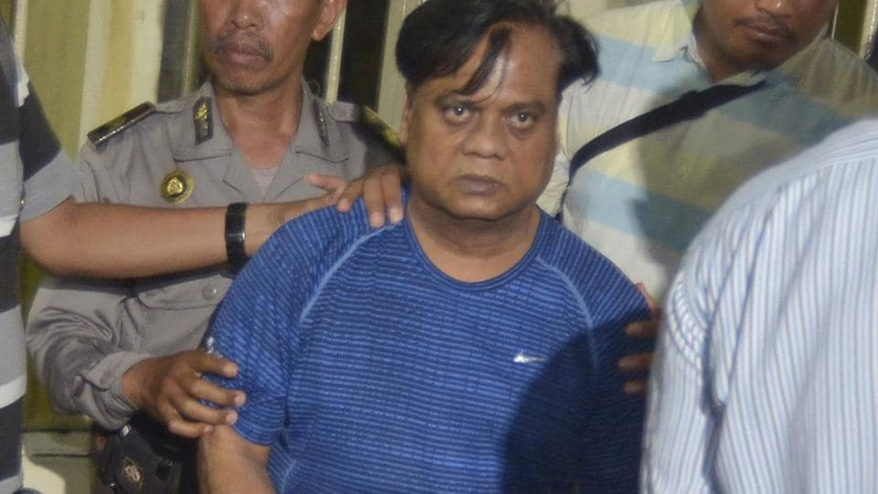 "Odisha police arrested four persons for  running an illegal ""telephone-exchange"" to camouflage extortion calls on behalf of gangster Chhota Rajan (in blue t-shirt) ."