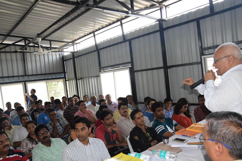 Former high court judge Kolse Patil speaks to IT employees who have been laid off, in Pune.