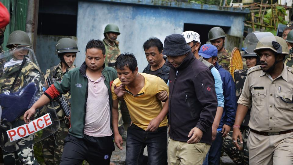 An injured man is taken away following clashes between Gorkhaland supporters and police in Sonada near Darjeeling on Saturday, July 8, 2017.