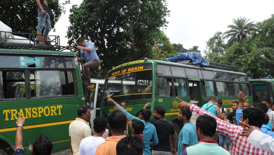 Taxi drivers stop vehicles in West Bengal's Siliguri on their way to Sikkim due to blockades carried out by Gorkha Janmukti Morcha activists on national highway 10.