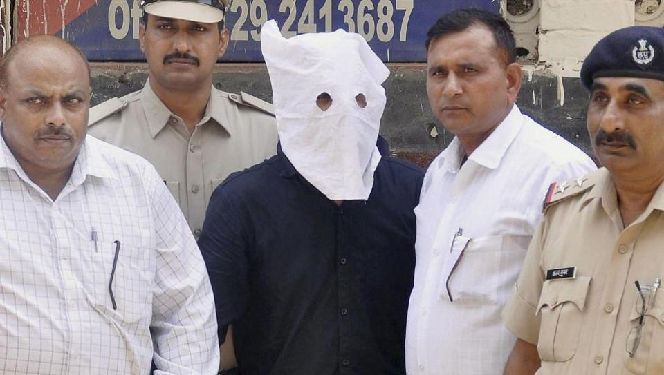 The main accused in Junaid Khan lynching case, before being produced in district court Faridabad on Sunday.