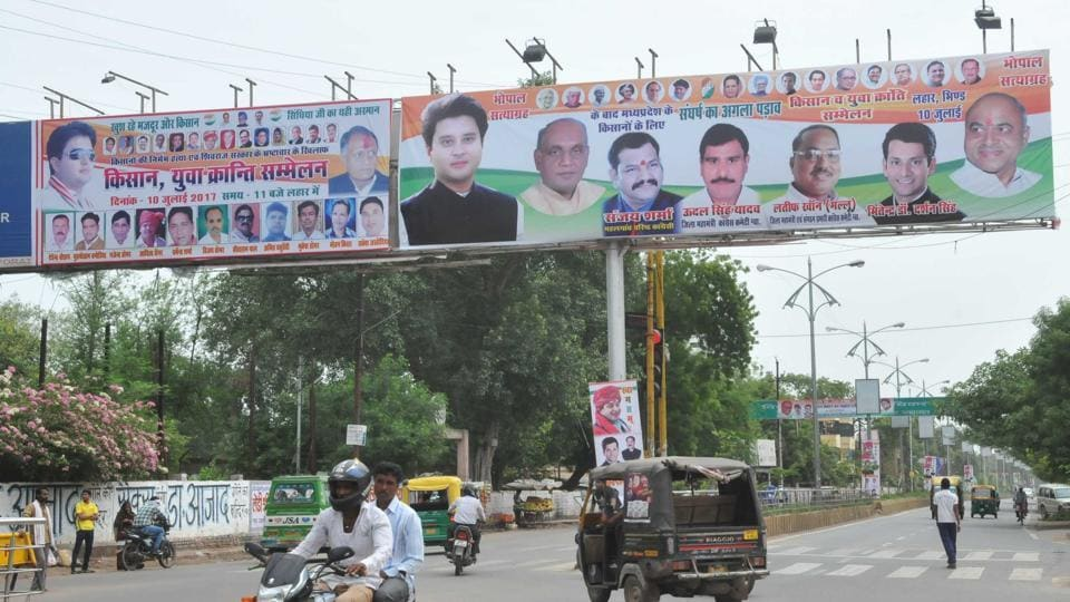 Hoardings with pictures of Congress leaders, including Jyotiraditya Scindia, holding the Kisan Sammelan (farmers' convention)in Lahar are seen on a road in Gwalior.