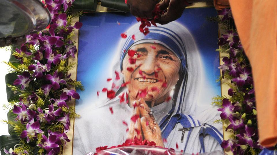 Before canonization of Mother Teresa, crowd offers flowers outside Mother House at AJC Boose road in Kolkata, in this file photo from September 4, 2016.