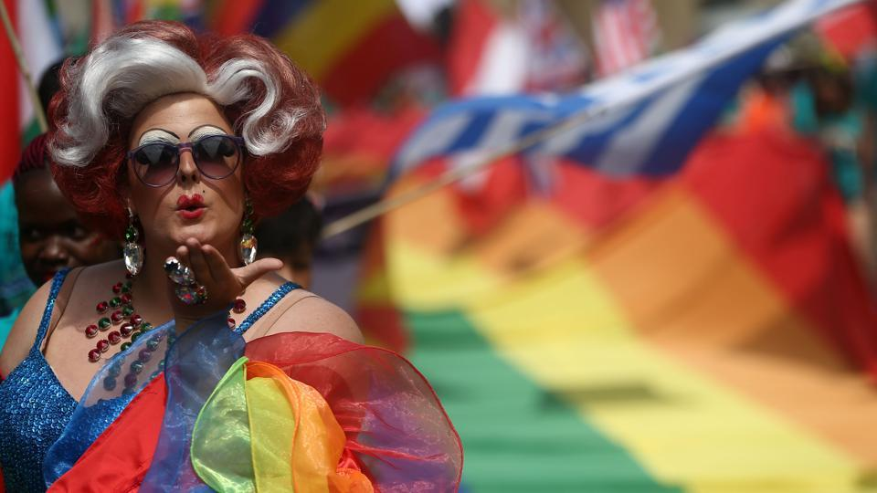 Participants attend the annual Pride in London Parade, which started in Portland Place and ends in Whitehall, in central London, Britain. (REUTERS)