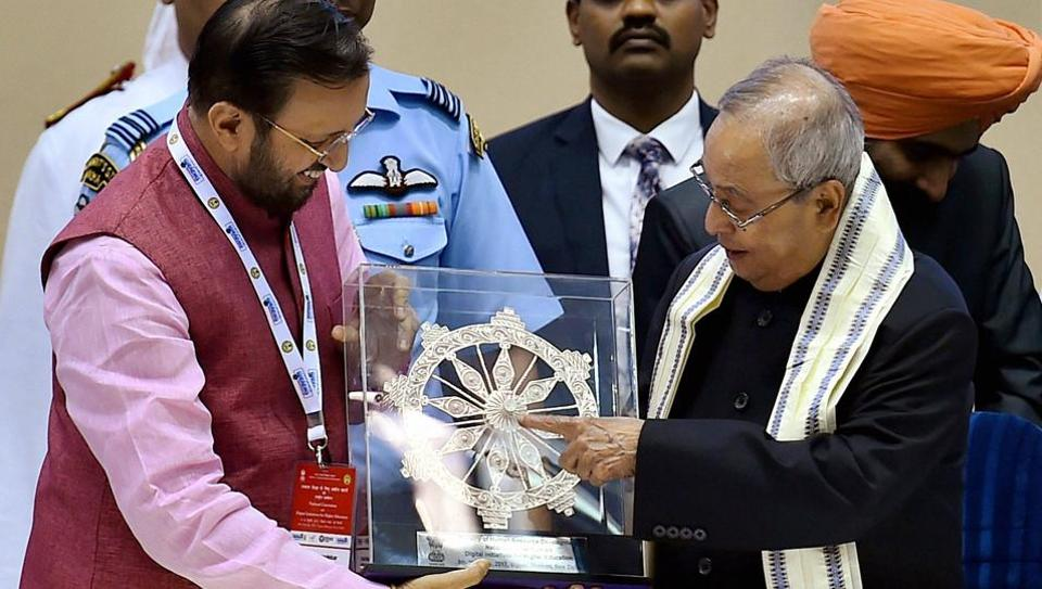 HRD minister Prakash Javadekar presents a memento to President Pranab Mukherjee during the National Convention on Digital Initiatives for Higher Education and the launch of SWAYAM, SWAYAM Prabha, and National Academic Depository in New Delhi on July 9.