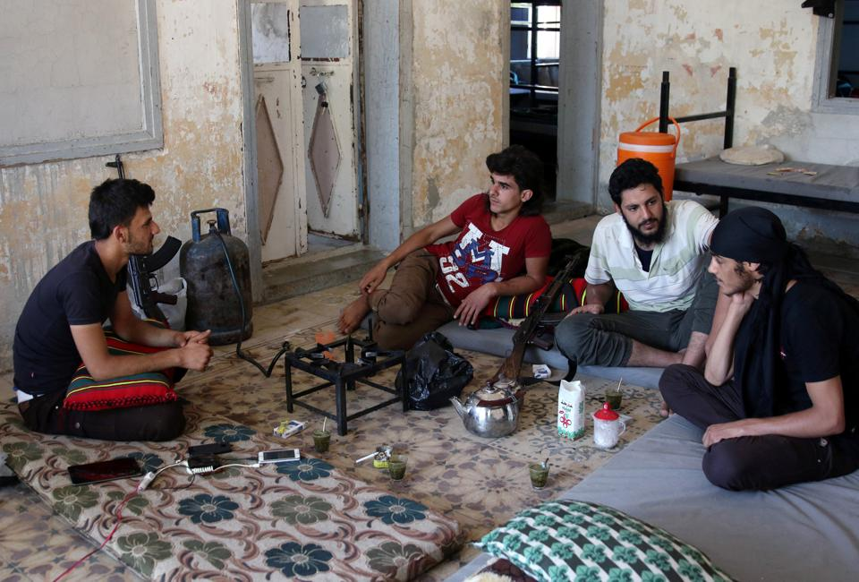Free Syrian Army fighters rest inside a room in Quneitra, Syria on July 8, 2017.