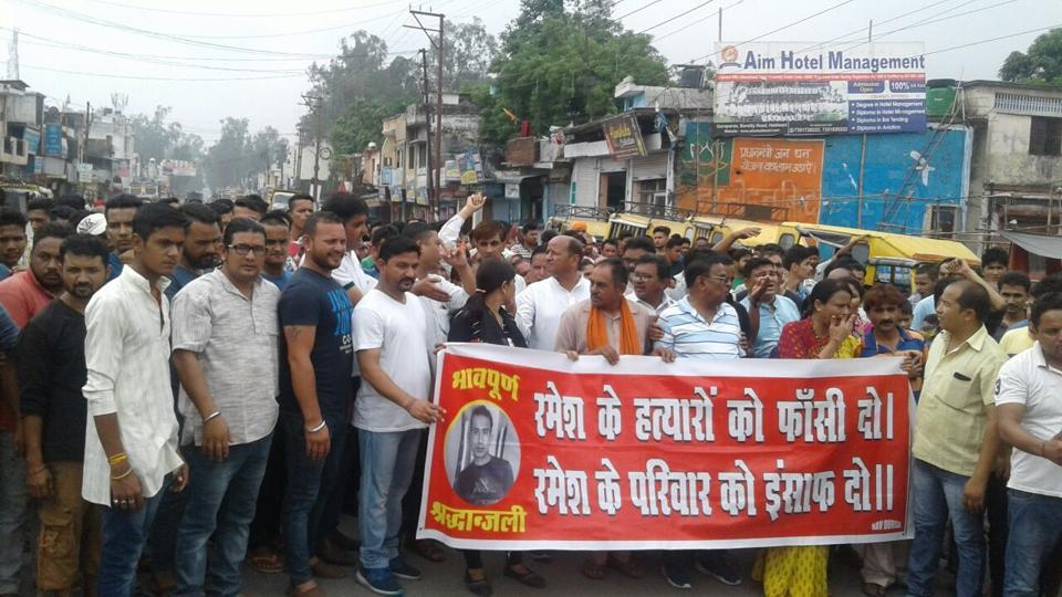 The residents of Bindukhatta (Lalkuan) take part in a protest march on Sunday demanding justice for Ramesh Bisht's family.