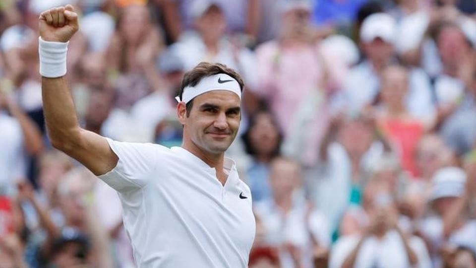 Switzerland's Roger Federer celebrates winning the third round match against Germany's Mischa Zverev.