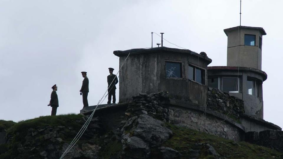 Chinese army personnel keep a close watch on Indian territory, at Nathula pass.