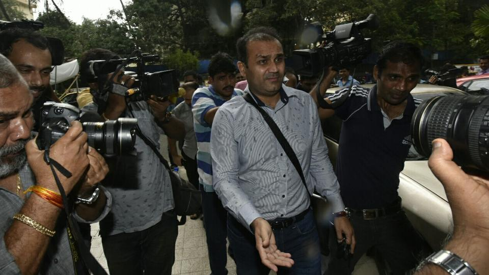 Virender Sehwag leaves the Cricket Centre after his interview. Get highlights of the Indian cricket team coach selection here