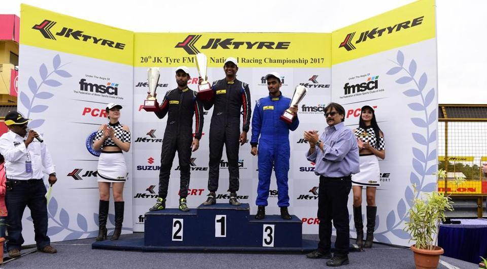 Vishnu Prasad (Centre) after winning the EURO JK1 race at 20th JK Tyre National Racing Championship