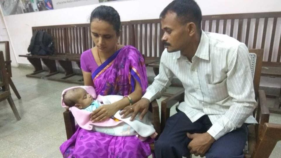 Guddu with his wife and son Priyom.