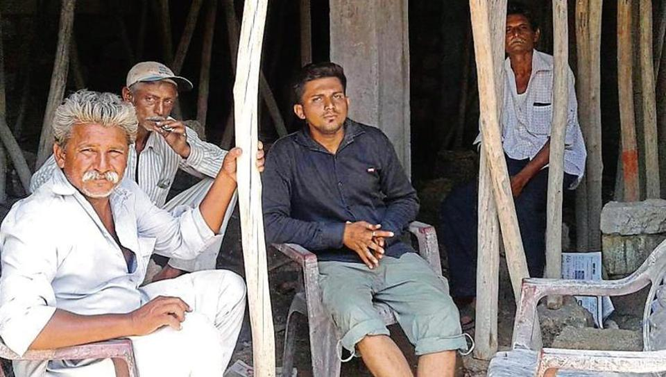 A year ago, seven Dalits were flogged for skinning a dead cow in Una; Jitu Sarvaiya (centre), the only Dalit from Mota Samadhiyala village to complete B.Tech, says they also want to lead a respectful life.