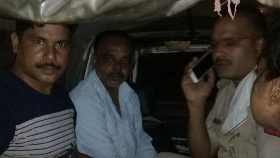 Kamal, 45, (in white shirt) after his arrest on Friday. Police said the former Uber cab driver allegedly used to terrorise his wife and children.
