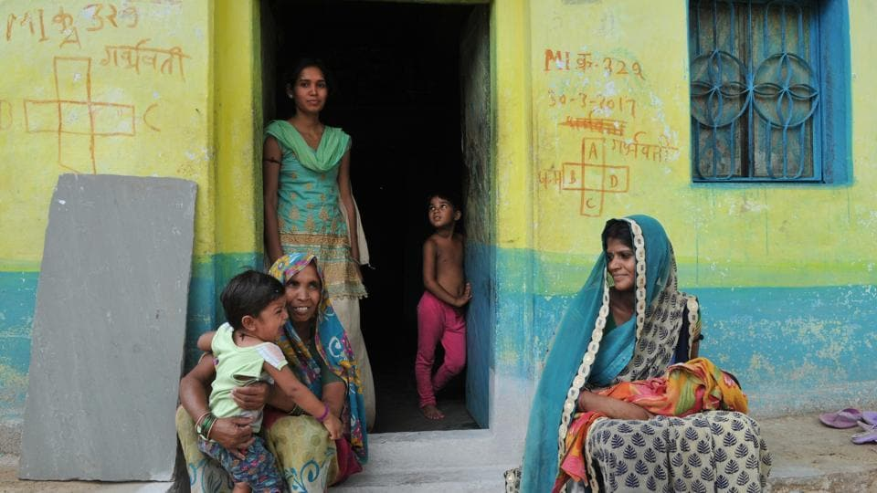 Rama Ahirwai (right) with her sons — 10-day-old unnamed one and 18-month-old Umang, mother-in-law Ramkali (left), and sister-in-law Anjali (standing), at their two-room home in Baroh village in Vidisha, Madhya Pradesh.