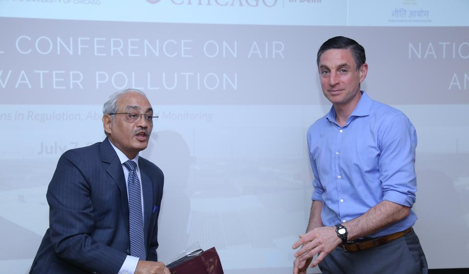 Justice Swatantra Kumar, chairperson of the NationalGreen Tribunal, left, with Michael Greenstone at the National Conference on Air and Water Pollution.