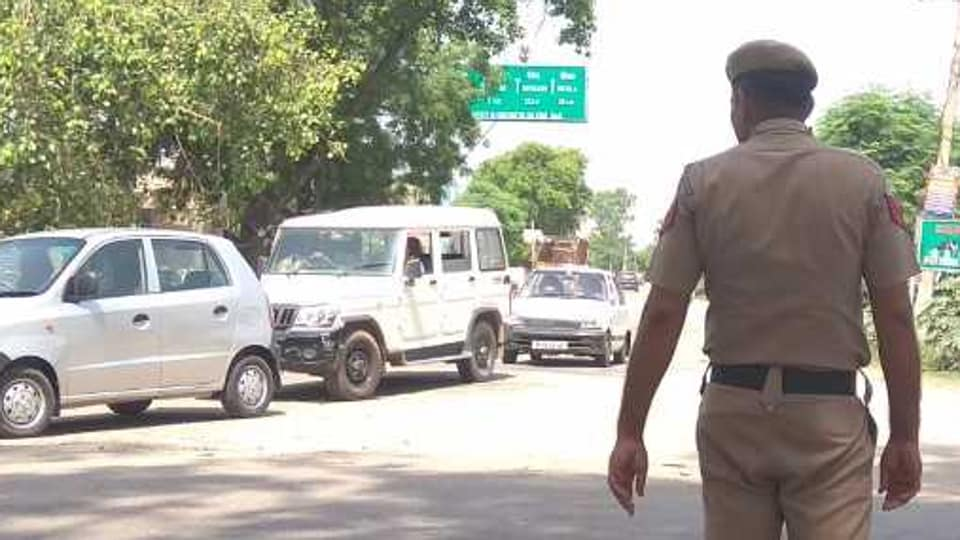 A police constable monitoring traffic movement at Pehowa-Patiala road on Monday.