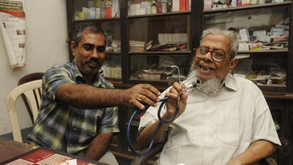 Compounder Debprasad Bairagi (left) has been working for the last 35 years with Dr Kaseed Ali (right) in Basirhat.