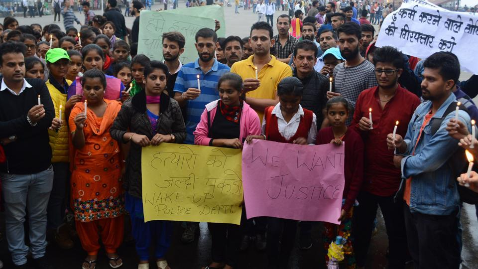 Locals took out a candle-light march on the Ridge, Shimla, on Monday