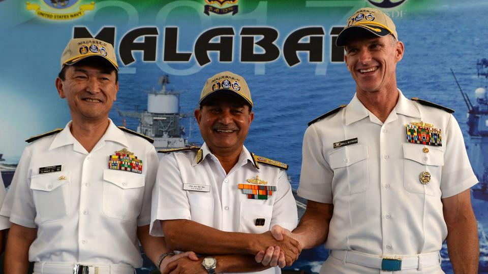 Japanese Rear Admiral Hiroshi Yamamura (L), US Rear Admiral William Byrne (R) and HCS Bisht, vice admiral of the Indian Navy, pose for photographers during the inauguration of joint naval exercises with the United States and India in Chennai on July 10.