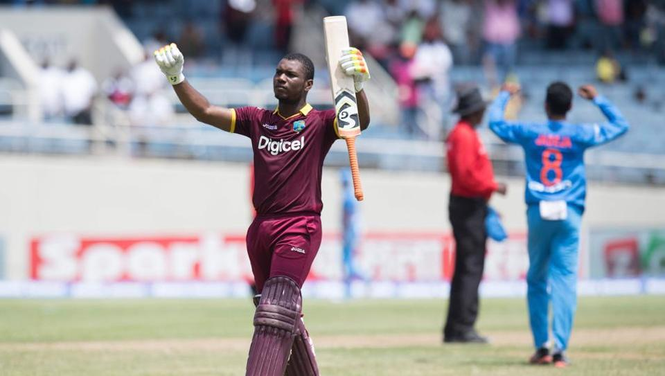 Evin Lewis celebrates his century during West Indies' one-off T20I against India at Kingston, Jamaica.