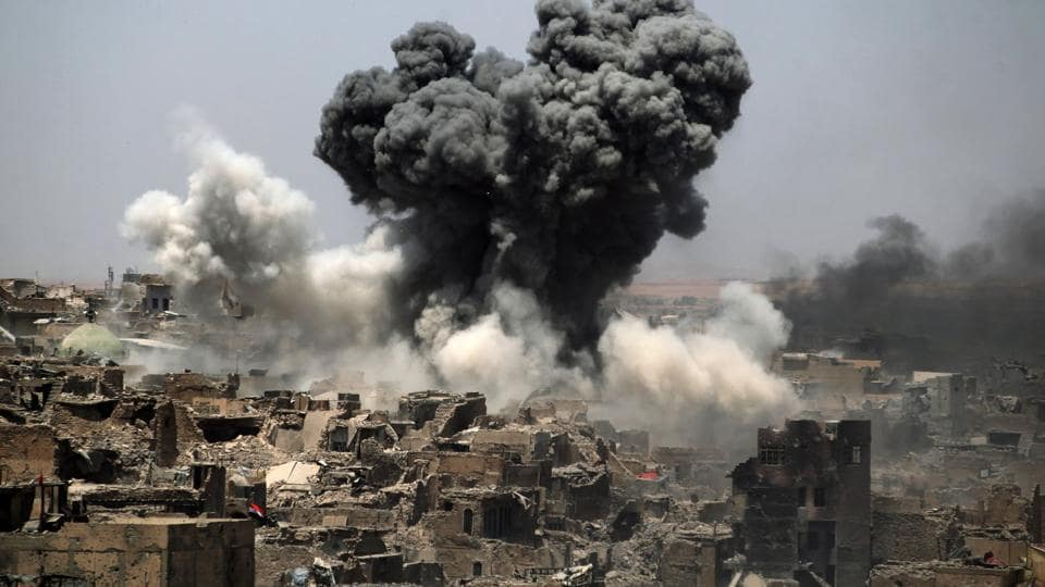 Smoke billowing following an airstrike by US-led international coalition forces targeting Islamic State (IS) group in Mosul. IS still controls swathes of western Iraq including much of the desert Anbar province and rival forces, which largely cooperated against the jihadists in Mosul, are expected to compete for a share of the spoils. (AHMAD AL-RUBAYE / AFP)