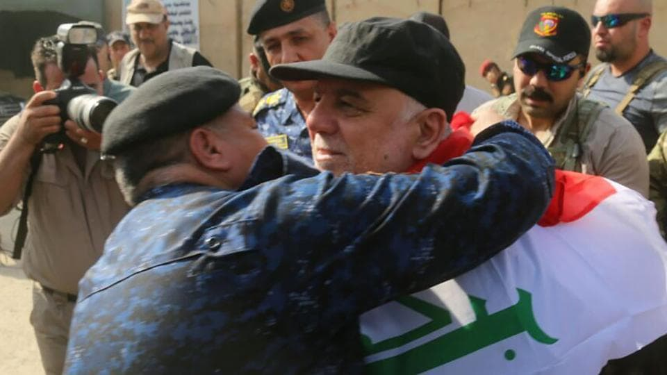 The prime minister joined hundreds of civilians in Mosul to celebrate the army's gains over ISIL. (AFP)