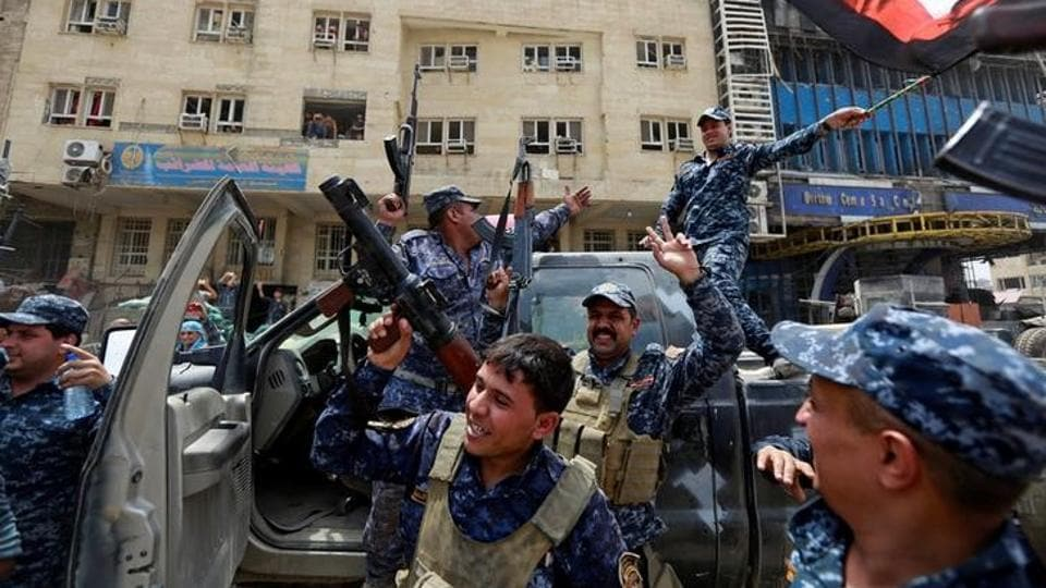 Iraqi Federal Police celebrate the victory in the Old City . (Ahmed Saad / Reuters)