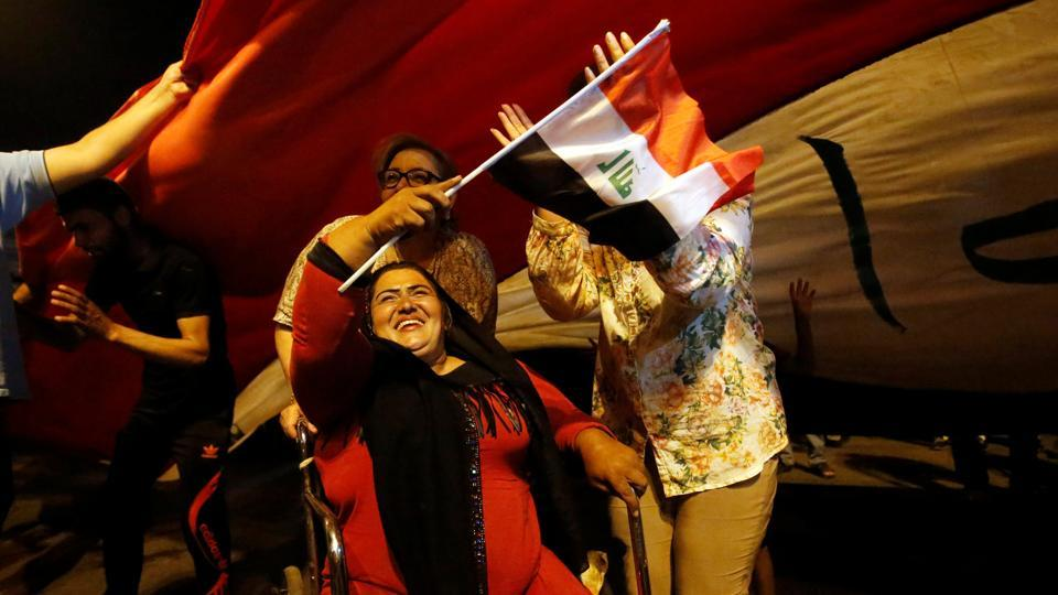 Iraqi people celebrate the liberation of the embattled city of Mosul in Baghdad. (Khalid al Mousily / REUTERS)