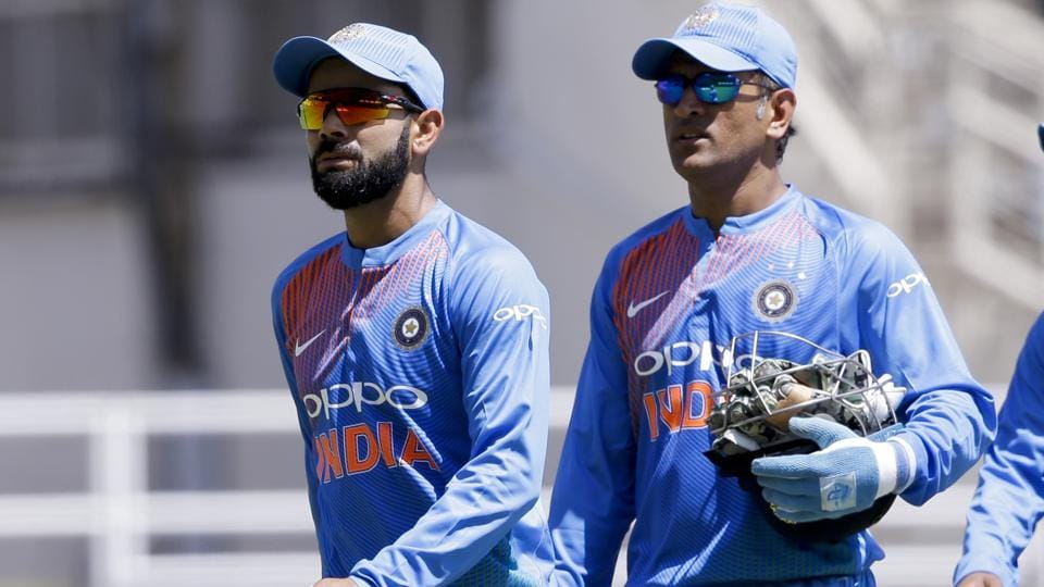 India captain Virat Kohli(L) and wicketkeeper MS Dhoni walk to the pavilion after losing to West Indies by 9 wickets a T20I at Sabina Park in Kingston, Jamaica, on Sunday.
