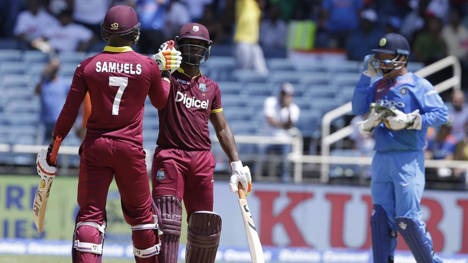 West Indies' Marlon Samuels and Evin Lewis celebrate beating India by nine wickets during the one-off T20I at Sabina Park in Kingston on Sunday.