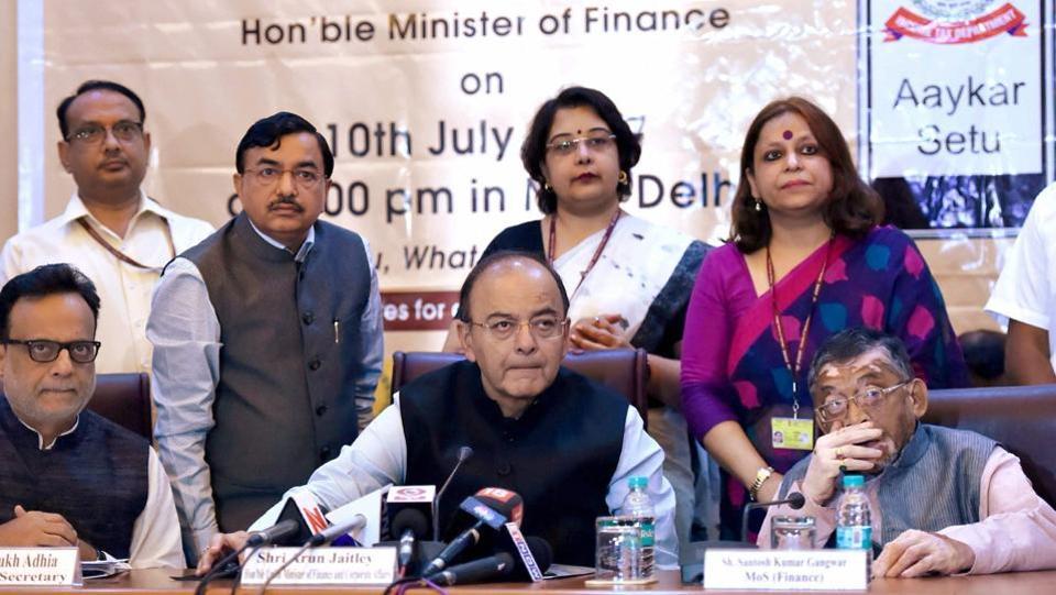 Finance minister Arun Jaitley with minister of state Santosh Gangwar (right) and revenue secretary Hasmukh Adhia (left) inaugurating the Aaykar Setu module in New Delhi on Monday.