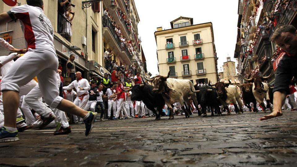 The San Fermin Festival attracts more than a million visitors to the city of Pamplona, in northern Spain, every year, from July 6 to 14. (Alvaro Barrientos / AP)