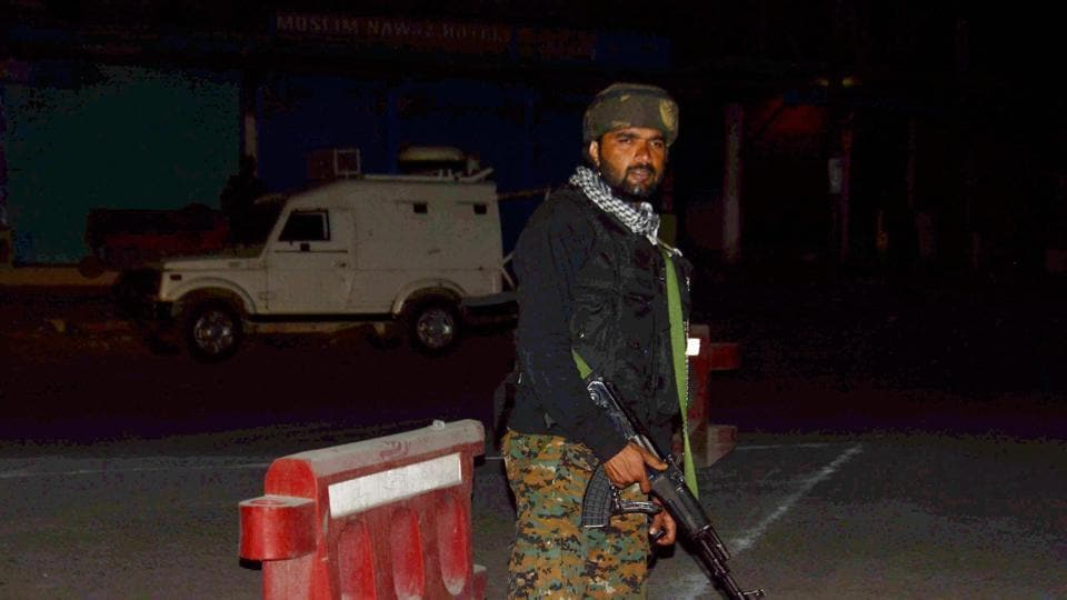 Security person stand guard after militants opened fire on the Amarnath Yatra in which seven pilgrims were killed 19 injured in Anantnag in Jammu and Kashmir on Monday.