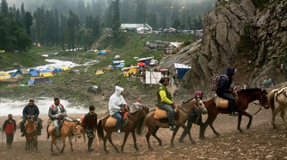 Hundreds of thousands of Hindu pilgrims trek over mountain trails to reach Amarnath caves, around 3,900 metres (12,800 feet) above sea level, in Kashmir every year (PTI)