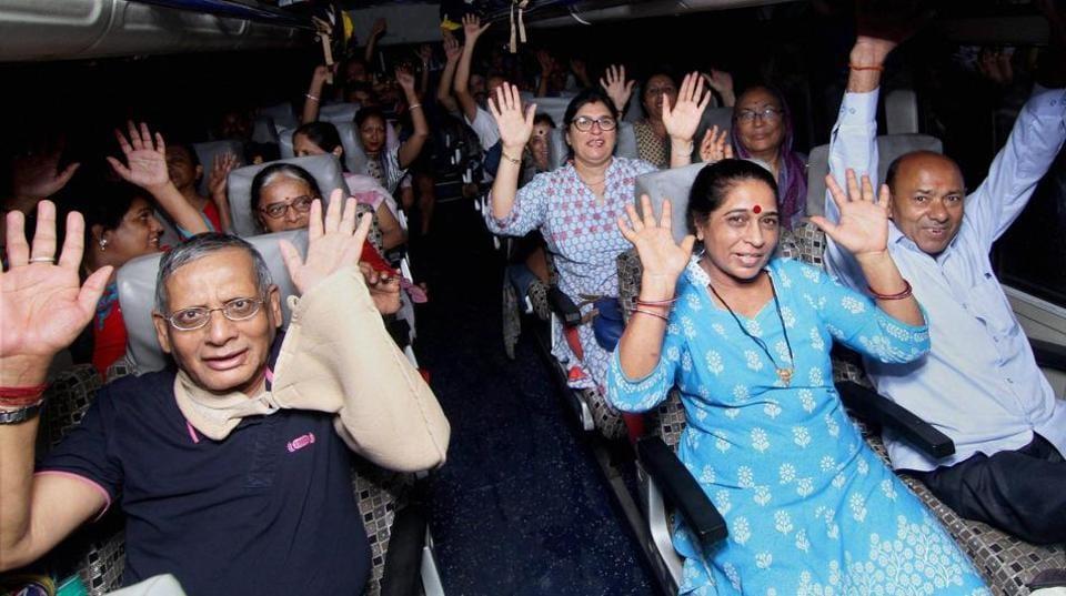 Amarnath Yatra pilgrims on the outskirts of Jammu on Tuesday.